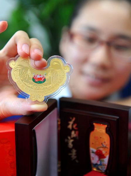 中钞国鼎黄金鸳鸯锁上市 抢眼民俗收藏金市场